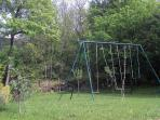 Garden play-ground for the kids, cool temperature in hot summer