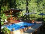 Take a refreshing dip in the pool or lounge on the deck overlooking the rivers!