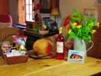 An amazing hamper! Fresh bread, bottle of wine, flowers, local goodies and fresh veg!