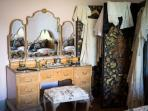 The dressing table in the 'boudoir' style bedroom