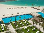 'Welcome to Dubai - View of Al Bateen pool area and private  beach and bar to the right '