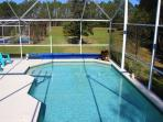 large heated pool with solar cover