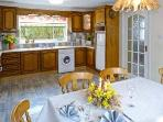 kitchen very well equipped with large dining table seating six