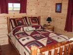 Private queen size log bedroom