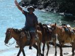 Take a liesurely horseback ride along the beach.