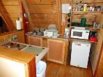 fully equipped kitchen (pots, pans, coffee maker, toaster, microwave, stove top, mini fridge)