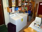 Hall access to garage with shared washer/dryer and utility sink