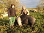 Your hosts Eva & Stephen with Lucy, the rare breed Saddleback pig