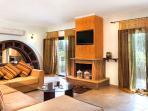 Living room, ground floor veranda, fireplace and TV set