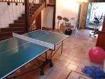 L-shape area of lounge/diner has table tennis & gym equipment