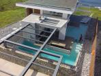 Aerial close-up of pool and BBQ area
