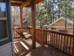 2nd floor deck includes a swinging bench to enjoy the views and peace.