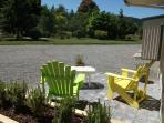 The front deck with nice colorful chairs to relax in the sun