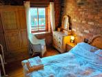 Accomodation is arranged over two Bedrooms both containing beautiful vintage wooden furniture.