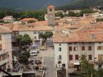 View of main Quillan square with river side Bar & restaurant terrace. Great for aperitif!