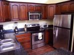 Kitchen with granite countertops & custom Costa Rican cabinets at villa