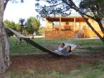 Kick back and relax in a hammock made for two under the shady trees...