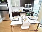 Chic kitchen with stainless steel appliances and granite counter top