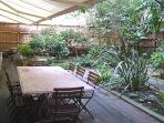 Garden with its marble art déco table