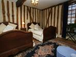 The columbage bedroom, two double beds