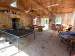 Game room with ping pong and pool tables