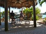 Relax under the shade of the Tiki Hut