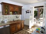 Kitchen with doors to south-facing terrace for outside dining with views of Canigou