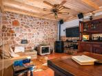 living room with flat tv, fire place, internet radio, ...