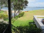 View from the master bedroom. Direct access to covered verandah, deck and beach