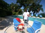 Tropical cool; Wayne brings some Red Stripe and rum punch drinks to the pool