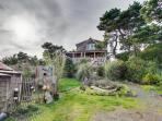 Dog-friendly home with guest cottage, private hot tub, and close beach access!