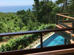 Two upstairs balconies with forest and ocean views