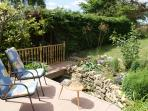 Enjoy a drink by the stream & enjoy the cottage garden