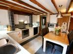 Kitchen with Induction Hob, Full Oven, Combi Microwave, Coffee Machine & Washing Machine.