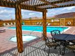 Located 1/2 block away behind the club house are the pool and hot tub for your use.