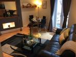 Modern open plan living, flat screen TV, dvd, cable tv, dvd's & games on request, in a comfy setting