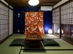 The same room with the paper doors half open to enable the guests to enjoy the Zen Garden.