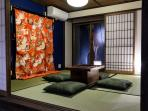 The Japanese room with old traditional wedding kimono and an old 'Hibachi' (fire pit).