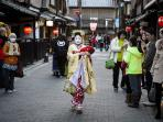 A Maiko walking down a street next to 'Hanamikoji' in Gion (15 min away)