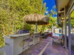 Outdoor Kitchen with BBQ, Sink, Fridge and Palapa Leadiing to Pool and Jacuzzi from Oceanfront Deck