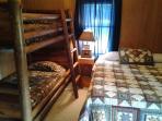 2nd bedroom 1 queen and a set of bunk beds