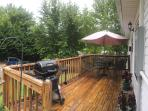 Open deck for outdoor dining and relaxation. Gas grill provided.