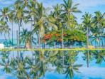 The infinity pool has stunning views of Kahaluu Beach Park.