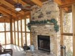 350 sqft outdoor screened in porch with fireplace and fire box blower for colder nights