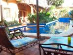 The next 8 photos are of the Primavera bungalow. Its poolside patio.