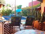All five bungalows enjoy their own poolside patio. This is the Villa del Sol's.