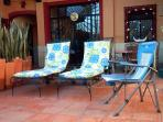 The next 12 photos of of the Villa del Sol. Chaise lounges, large table & 4 chairs.