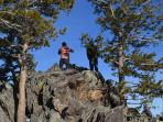 My son at the top of one of our high peaks by the cabin.