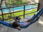 Spacious balcony/patio with hammock overlooking the jungle and pool
