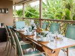 Upper covered lanai with dining and lounging area